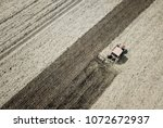 air view of of plowing red... | Shutterstock . vector #1072672937