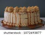 caramel buttercream frosted...   Shutterstock . vector #1072693877