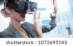 Small photo of Digital composite of Digital composite image of businesswoman touching futuristic screen while using VR glasses