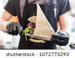 chef serving vegetarian salmon... | Shutterstock . vector #1072773293