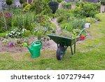 Wheelbarrow And Watering Can I...