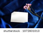 Small photo of Navy blue silk and white paper. Theme for luxurious classic. Start idea for everything design - postcard, pictures, write note. Lest to use it !!!