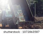 dump truck preparing ground for ... | Shutterstock . vector #1072863587