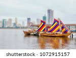 """Small photo of Manila, Philippines -- April 9, 2018. Illustrative editorial. Example of a traditional Filipino wooden sailing vessel called a balangay. The """"Sultan Sin Sulu"""" is a replica docked in Manila Bay."""