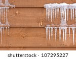 icicles hang from a wood cabin... | Shutterstock . vector #107295227