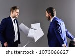 Small photo of Businessman rejects the contract and throw papers in air. Unfavorable deal concept. Men in suit or businessmen with unhappy expression with paper documents or contracts on dark background.