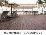 wooden deck with lounge sunbeds ... | Shutterstock . vector #1073084393