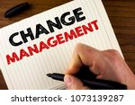 Small photo of Conceptual hand writing showing Change Management. Business photo showcasing replace leaderships or People in charge Replacement written by Man Notebook Book Wooden background Marker.