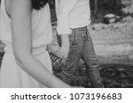 beautiful young couple walking... | Shutterstock . vector #1073196683