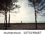 young couple by the river. the... | Shutterstock . vector #1073198687