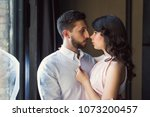 young couple hugging by the... | Shutterstock . vector #1073200457