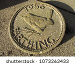 Small photo of Replica Farthing Coin garden ornament