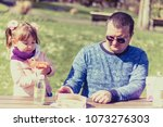 daughter and dad are having... | Shutterstock . vector #1073276303