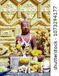 Small photo of Buddha statue made of laterite stone.