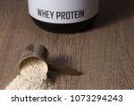 whey protein food supplement... | Shutterstock . vector #1073294243