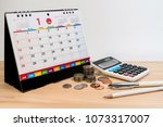 money pen calculator and desk... | Shutterstock . vector #1073317007
