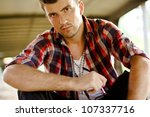 Portrait of young man in suburb street. - stock photo