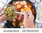 chef putting peas for cooking   ... | Shutterstock . vector #1073424233