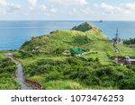 Small photo of Dragons head hill reaching into the ocean with view on Hamal Castawa Memorial at Yongmeori Beach, Sanbang-ro, Jeju Island, South Korea