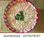 salade olivier is a salad... | Shutterstock . vector #1073476547