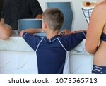 teenager waits a pancake to be...   Shutterstock . vector #1073565713