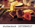 unfinished dinner of steak with ...   Shutterstock . vector #1073584517