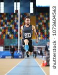 Small photo of ISTANBUL, TURKEY - JANUARY 07, 2018: Undefined athlete triple jumping during Turkish Athletic Federation Olympic Threshold Indoor Competitions