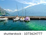 view on lake garda and yacht in ...   Shutterstock . vector #1073624777