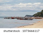 many fishing boats mooring... | Shutterstock . vector #1073666117
