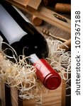 Bottle of red wine in gift wooden box - stock photo