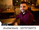 a young handsome caucasian man... | Shutterstock . vector #1073726573