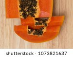 a papaya fruit is cut into... | Shutterstock . vector #1073821637