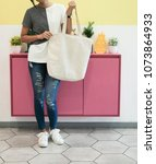 woman showing white totebag.... | Shutterstock . vector #1073864933