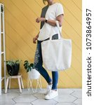 woman showing white totebag.... | Shutterstock . vector #1073864957