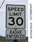 Small photo of Speed limit 35 miles per hour MPH, and radar enforced signs.