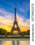 paris eiffel tower and champ de ... | Shutterstock . vector #1073902373