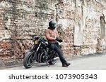 man a motorcyclist standing... | Shutterstock . vector #1073905343
