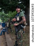 Small photo of August 12, 2017 Charlottesville, Virginia USA - Armed militia with assault rifles defending right to bare arms to protect the people.