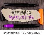 Small photo of Text sign showing Affiance Marketing. Conceptual photo joining two or more companies in same field mutual goal written on Tear Cardboard Paper on the wooden background Markers next to it.