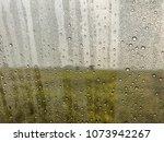 the rain falls on the glass ... | Shutterstock . vector #1073942267