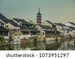 qiandeng ancient town... | Shutterstock . vector #1073951297