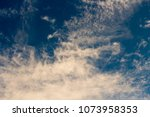 white  and grey cirrostratus... | Shutterstock . vector #1073958353