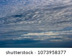 white  and grey cirrostratus... | Shutterstock . vector #1073958377