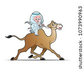 arabic kid riding camel happily ... | Shutterstock .eps vector #1073990963
