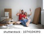 selfie in the new house  | Shutterstock . vector #1074104393