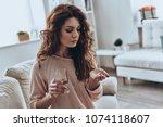 painkiller. sick young women... | Shutterstock . vector #1074118607