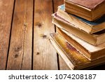 various old books on a wooden... | Shutterstock . vector #1074208187
