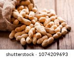 close up of peanuts in a sack... | Shutterstock . vector #1074209693