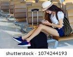 asian woman teenager using... | Shutterstock . vector #1074244193