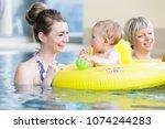 mums and their children having... | Shutterstock . vector #1074244283